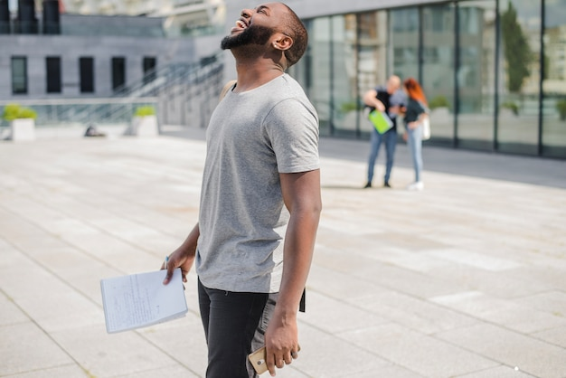 Laughing black man with papers