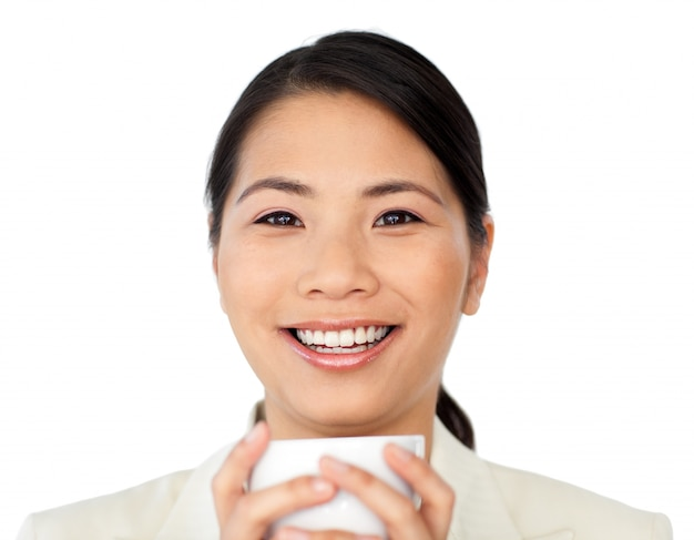 Laughing businesswoman drinking coffee