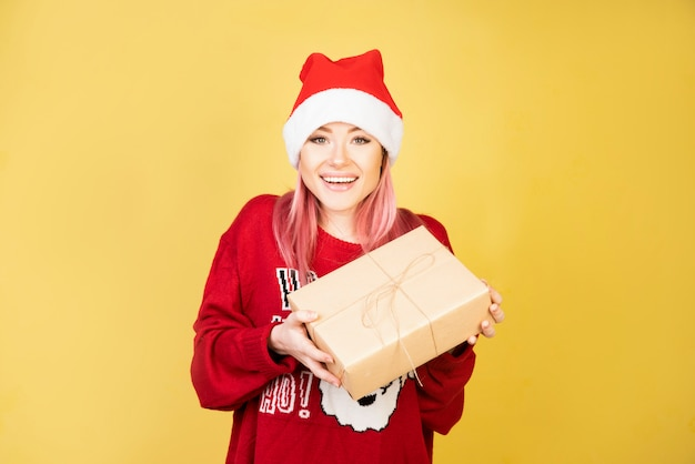 Laughing girl with gifts in hands