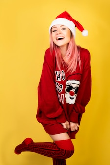 Laughing girl with red santa suit