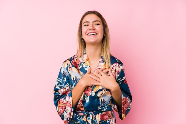 Laughing keeping hands on heart, concept of happiness.