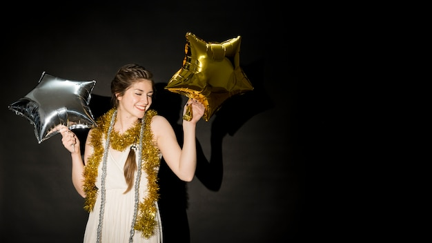 Laughing lady in evening wear with balloons