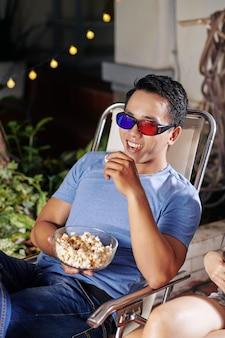 Laughing man watching movie