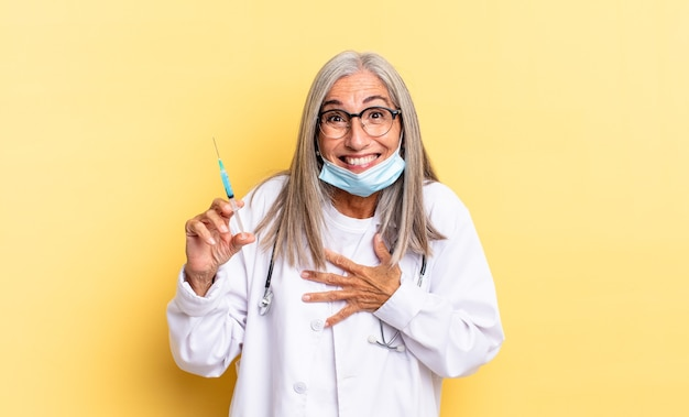 Laughing out loud at some hilarious joke, feeling happy and cheerful, having fun. doctor and vaccine concept