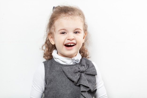 Laughing pretty little girl with curly hair. close-up. Premium Photo