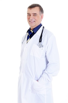 Laughing successful mature doctor in hospital gown and with stethoscope