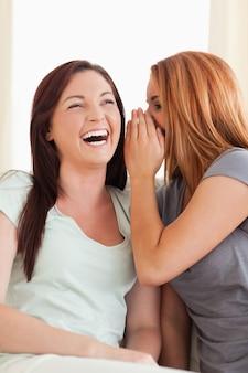 Laughing woman being told something