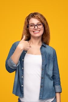 Laughing woman pointing at self and smiling at camera