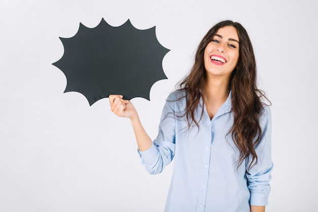 Laughing woman presenting speech bubble slate