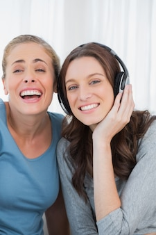 Laughing women listening to music