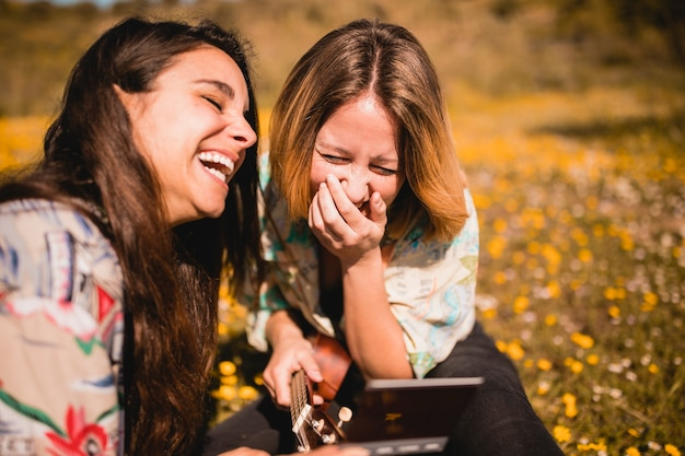 Laughing women with picture