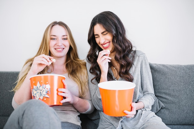 Laughing women with popcorn