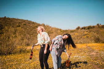 Laughing women with ukuleles