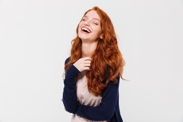 Laughing young redhead lady. eyes closed.