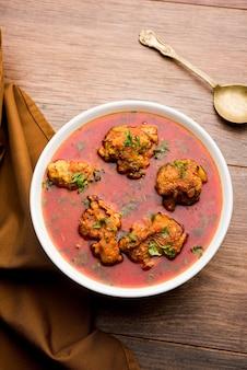 Lauki kofta curry made using bottel gourd or doodhi, served in a bowl or karahi. selective focus