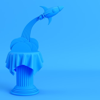 Launch rocket from a pillar on bright blue background