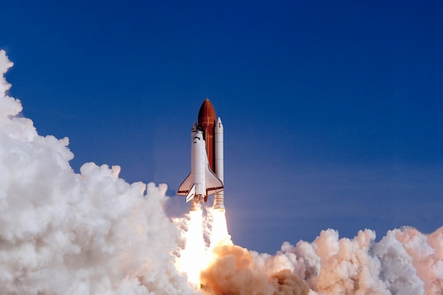 The launch of the space shuttle against the background of the sky and smoke. elements of this image furnished by nasa. high quality photo