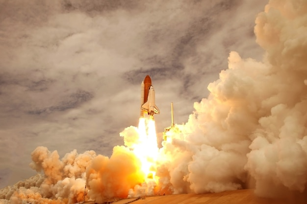 The launch of the space shuttle, with smoke and fire. elements of this image were furnished by nasa.for any purpose.