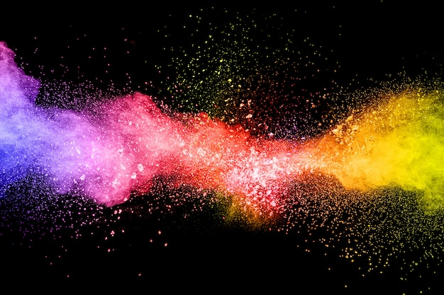 Launched colorful powder on black background.color powder explosion.colorful dust splashing.