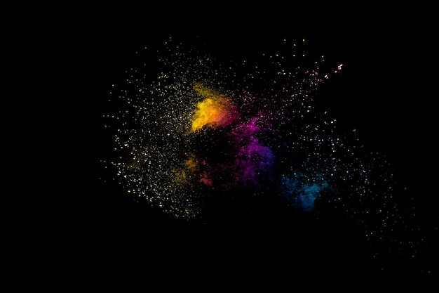 Launched multicolored powder on black background.color powder explosion.colorful dust splashing.