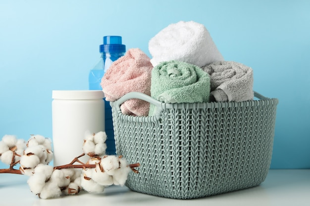 Laundry accessories on white table against blue table
