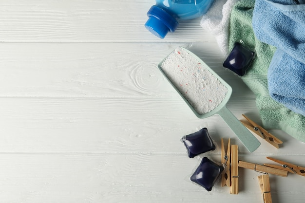 Laundry accessories on white wooden table, top view