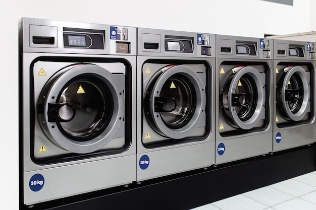 Laundry machines in public laundromat.