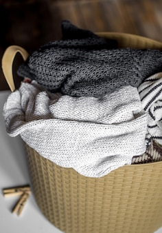 Laundry, warm clothes in the hamper, wash