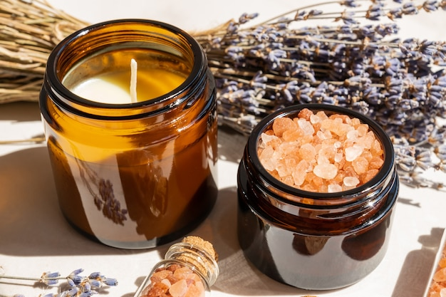Lavander salt with natural spa products and decor for bath on marble background
