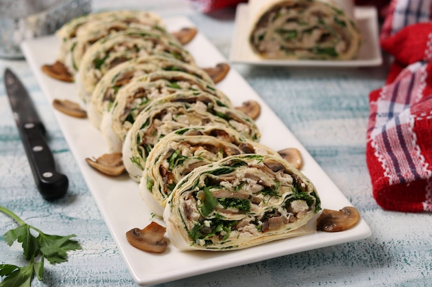 Lavash roll with champignons, chicken, cheese and parsley