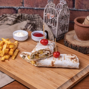Lavash sandwiches with french fries and sauces.