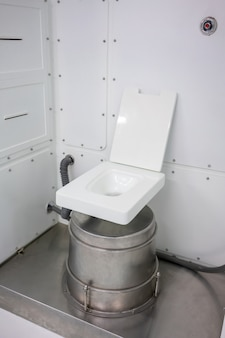 Lavatory room inside the space station. empty toilet with a toilet bowl in a spacecraft.