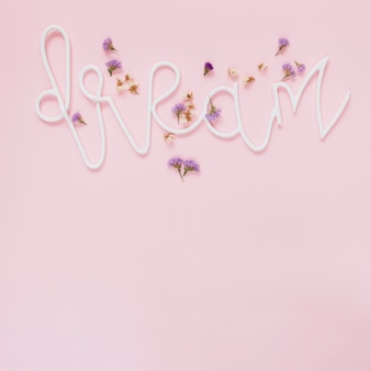 Lavender and white flowers on dream text over the pink background