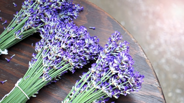 Lavender bouquet on wood table top view angle at furano hokkaido japan which flowers are full bloom