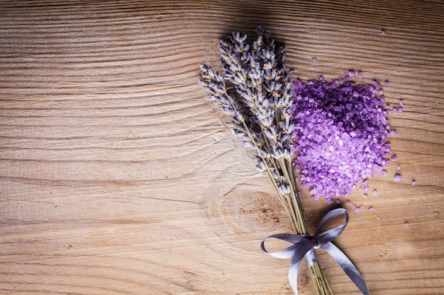 Lavender bunch and sea salt on the wooden table