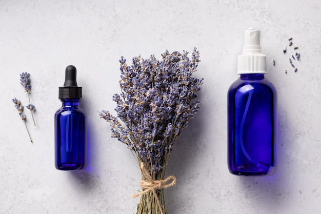 Lavender essential oil mist in blue bottles aromatherapy treatment natural spa cosmetics