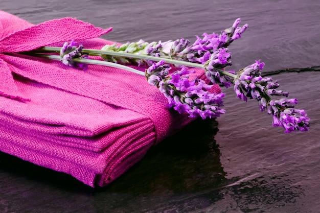 Lavender flower over purple napkin