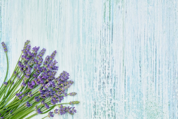Lavender flowers bouquet on blue wooden background. copyspace, top view.