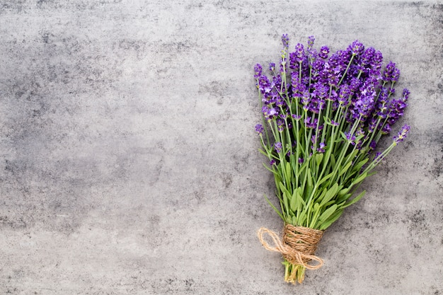 Lavender flowers, bouquet on rustic background