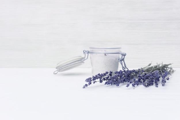 Lavender flowers and jar with sea salt.