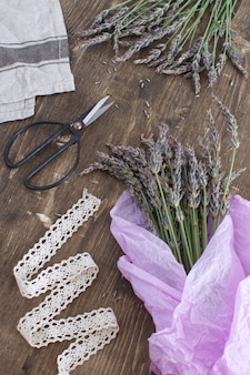Lavender harvesting lavender bouquet on dark wooden  aromatherapy  vintage french provence style