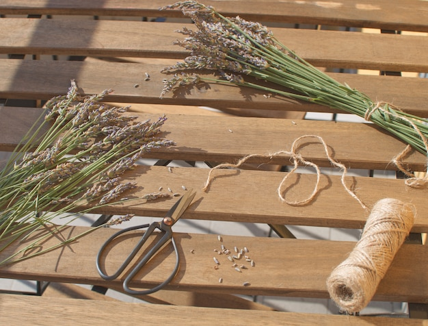 Lavender harvesting lavender bunch on wooden table with sunlight aromatherapy traditional medicine