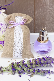 Lavender herbal water, fresh blue flowers and dry in pouch close up