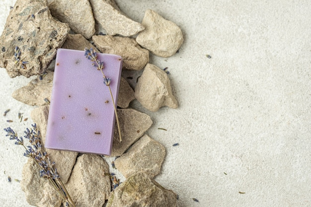 Lavender soap on rocks with copy space