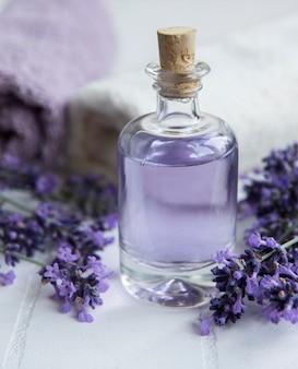 Lavender spa essential oils  towels and fresh lavender