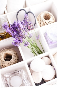 Lavender spa with rebbles, candles and white towels in a box