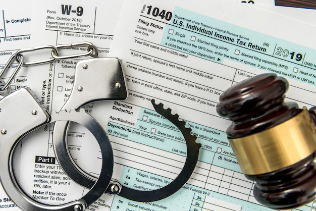 Law concept, 1040 finance tax form with gavel and handcuff