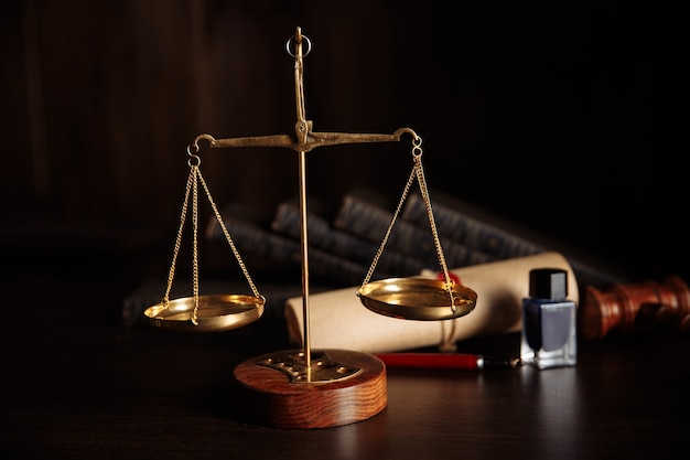 Law concept. judge's gavel and libra in courtroom library.