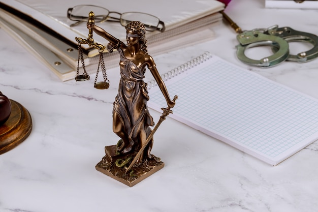 Law figure justice statue in lawyer with file folder law office working document