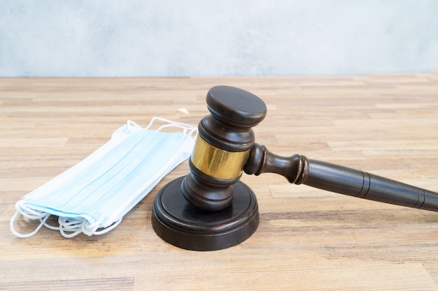 Law gavel and face anti virus masks, medical law concept